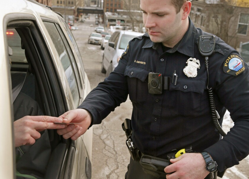 A red light on the body camera worn by Duluth, Minn. police officer Dan Merseth indicates it is active during a traffic stop in February.