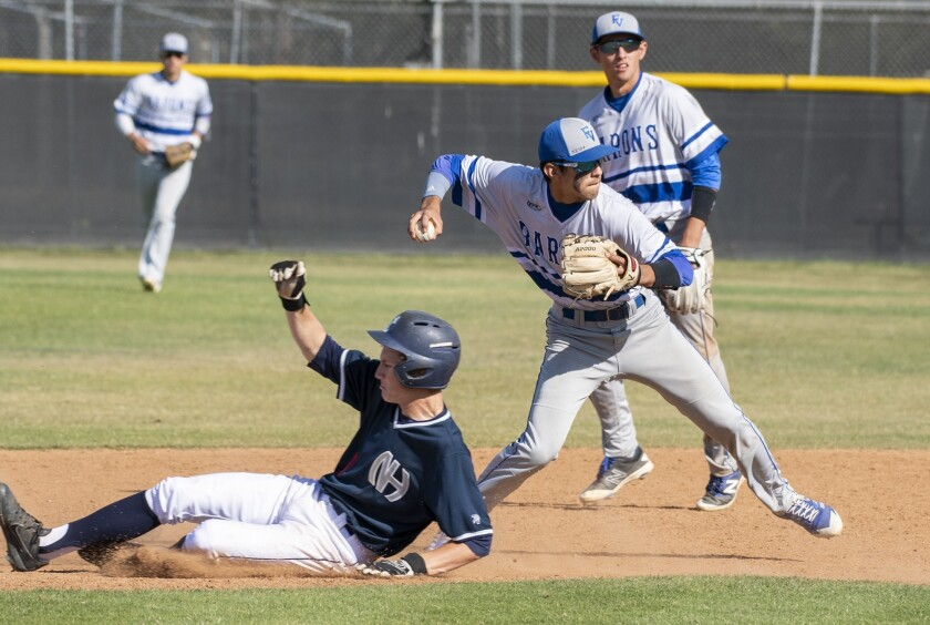 Fountain Valley's Sebastian Murillo gets the force out at second against Newport Harbor's John Olmst