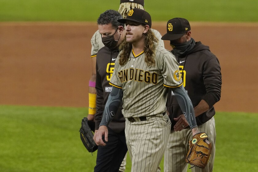 San Diego Padres starting pitcher Mike Clevinger leaves the game with an injury in NLDS
