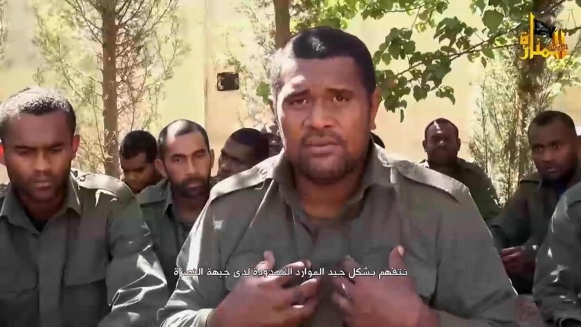 """This image made from video posted on a militant social media account on Thursday, Sept. 11, 2014 shows U.N. peacekeepers from Fiji held captive by militants from the Nusra Front in Syria. Al-Qaida-linked Syrian rebels on Thursday released all 45 Fijian peacekeepers they had held captive for two weeks, the United Nations said, bringing an end to a crisis that had pulled the U.N. monitoring force into the chaos of Syria's civil war. Arabic reads, """"we truly understand the limited resources that Nusra Front have."""" (AP Photo via militant social media account)"""