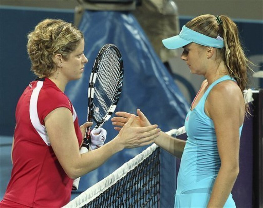Kim Clijsters of Belgium, left, shakes hands with Daniela Hantuchova of Slovakia, right, after Clijsters retired injured in their semi final match during the Brisbane International tennis tournament in Brisbane, Australia, Friday, Jan. 6, 2012. (AP Photo/Tertius Pickard)