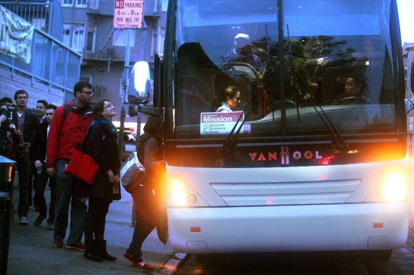 San Francisco will begin charging the operators of private shuttles that ferry technology workers from the city to Silicon Valley. Above, passengers in San Francisco board a private shuttle to the Google campus in Mountain View.