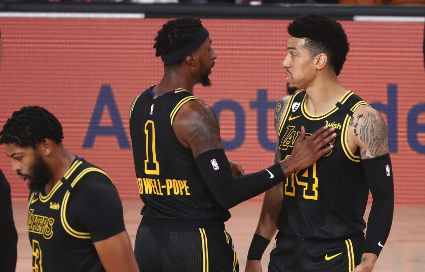 Lakers guards Danny Green, right, and Kentavious Caldwell-Pope talk during Game 4 against Portland on Aug. 24, 2020.