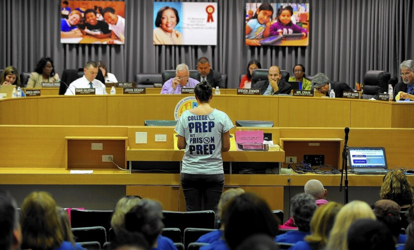 L.A. Unified board members listen to a speaker during a budget meeting at the district headquarters in downtown L.A.