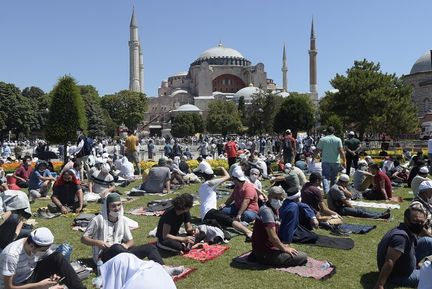 Worshipers wait outside the Hagia Sophia in Istanbul