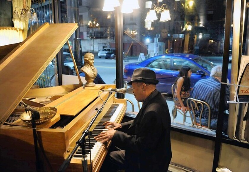 A pianist tickles the ivories at Café D'Mongo's, a speak-easy that has reopened thanks to downtown Detroit's growing revitalization.
