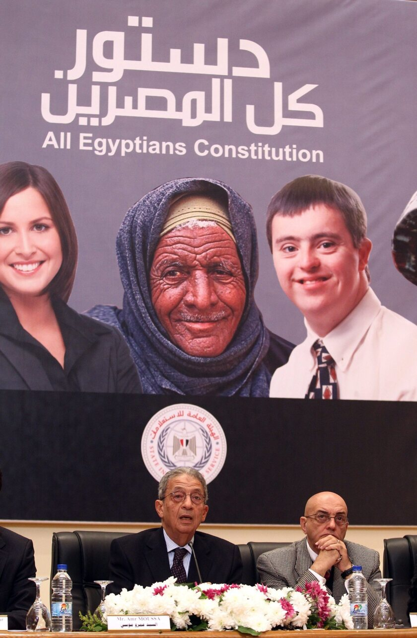 """A banner meant to depict """"all Egyptians"""" is displayed at a news conference to kick-start the campaign to win approval of an amended constitution."""