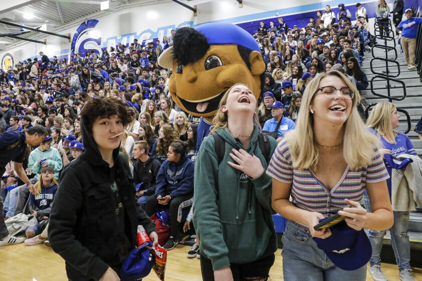 Students give a warm welcome to Dodgers players at Saugus High School during a school pep rally Friday.