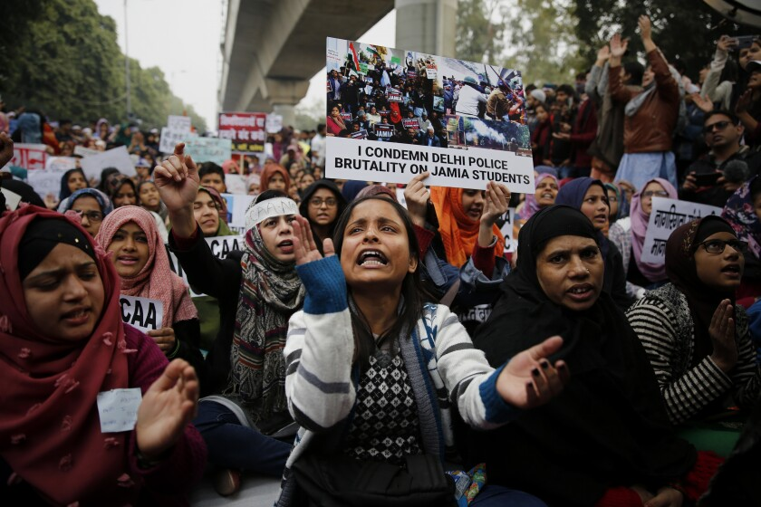 Students of Jamia Millia Islamia university in New Delhi protest against a new citizenship law on Dec. 21.