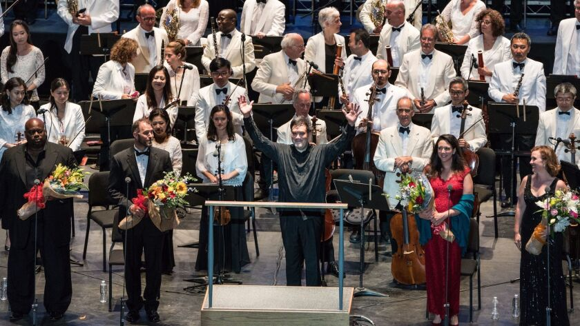 Alan Gilbert acknowledges the crowd after conducting the New York Philharmonic at a community concer