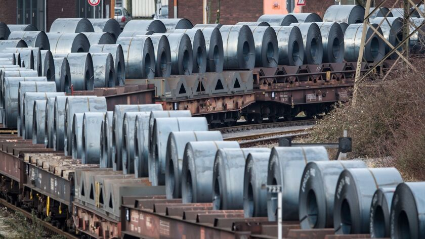 Coils of steel stand on trains in front of the ThyssenKrupp steel mill in March in Duisburg, Germany.