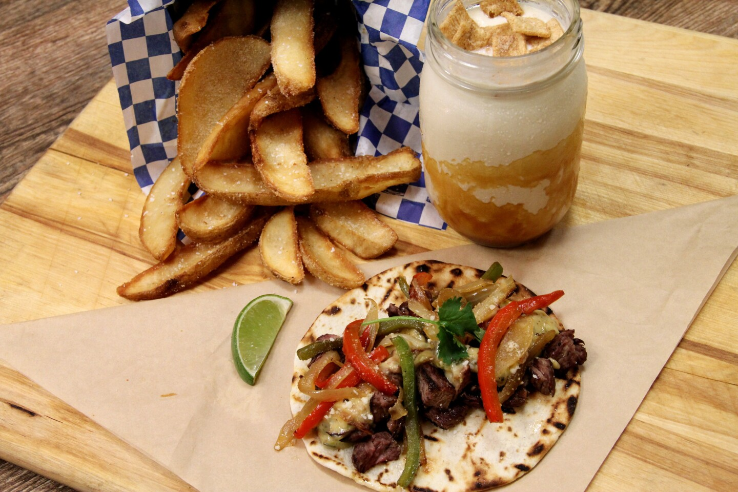 """Fries, the """"Brotherly Love"""" taco and a milkshake from U.S. Taco Co., opening in the next few months in Huntington Beach."""