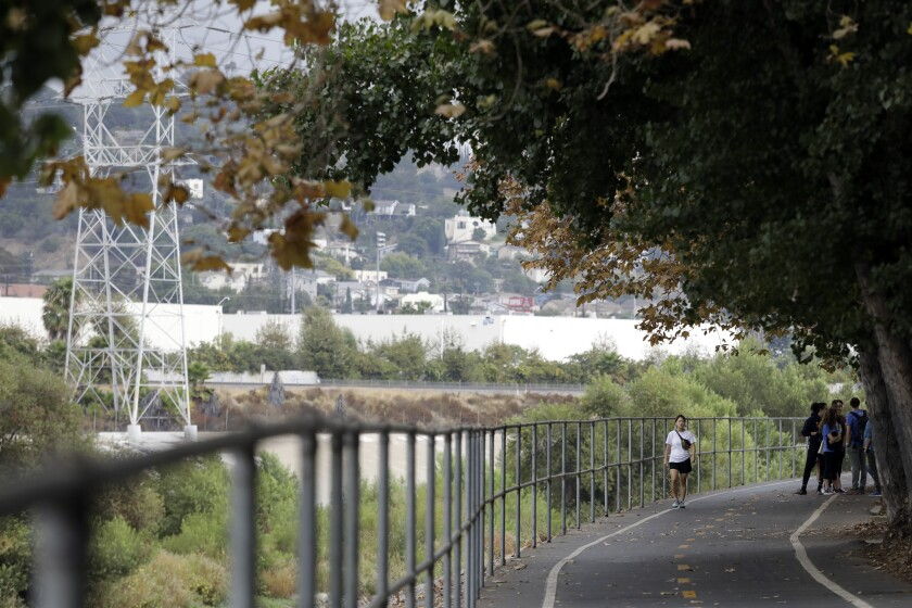 Pedestrians walk along the Los Angeles River Bike Path near Glassell Park and Atwater Village.