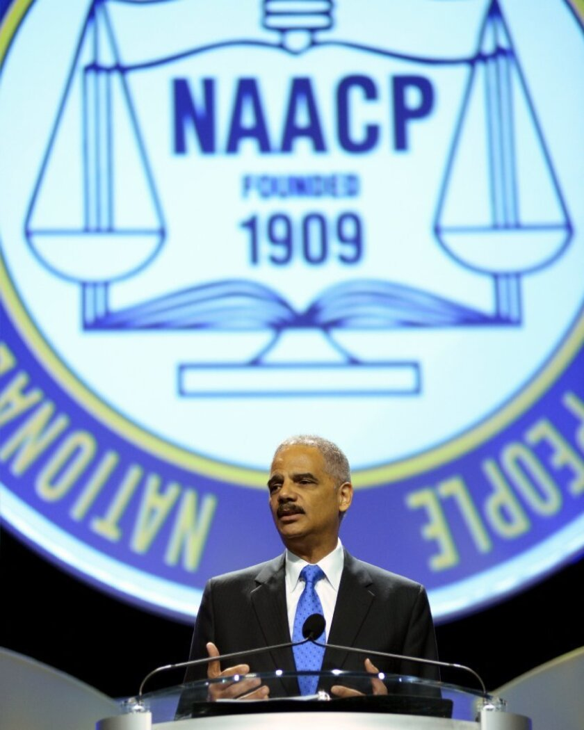 """Atty. Gen. Eric H. Holder Jr. speaks to the National Convention of the NAACP on Tuesday in Orlando, Fla. Holder condemned """"stand your ground"""" laws and discussed the George Zimmerman not-guilty verdict in the shooting death of Trayvon Martin."""