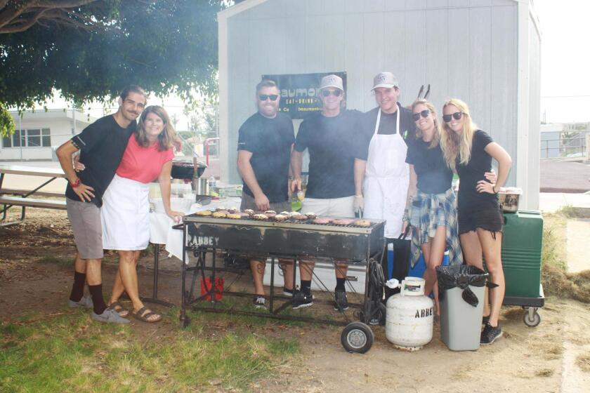 The team from Beaumont's Eatery grill up burgers at the annual Bird Rock community picnic Aug. 1, 2017.