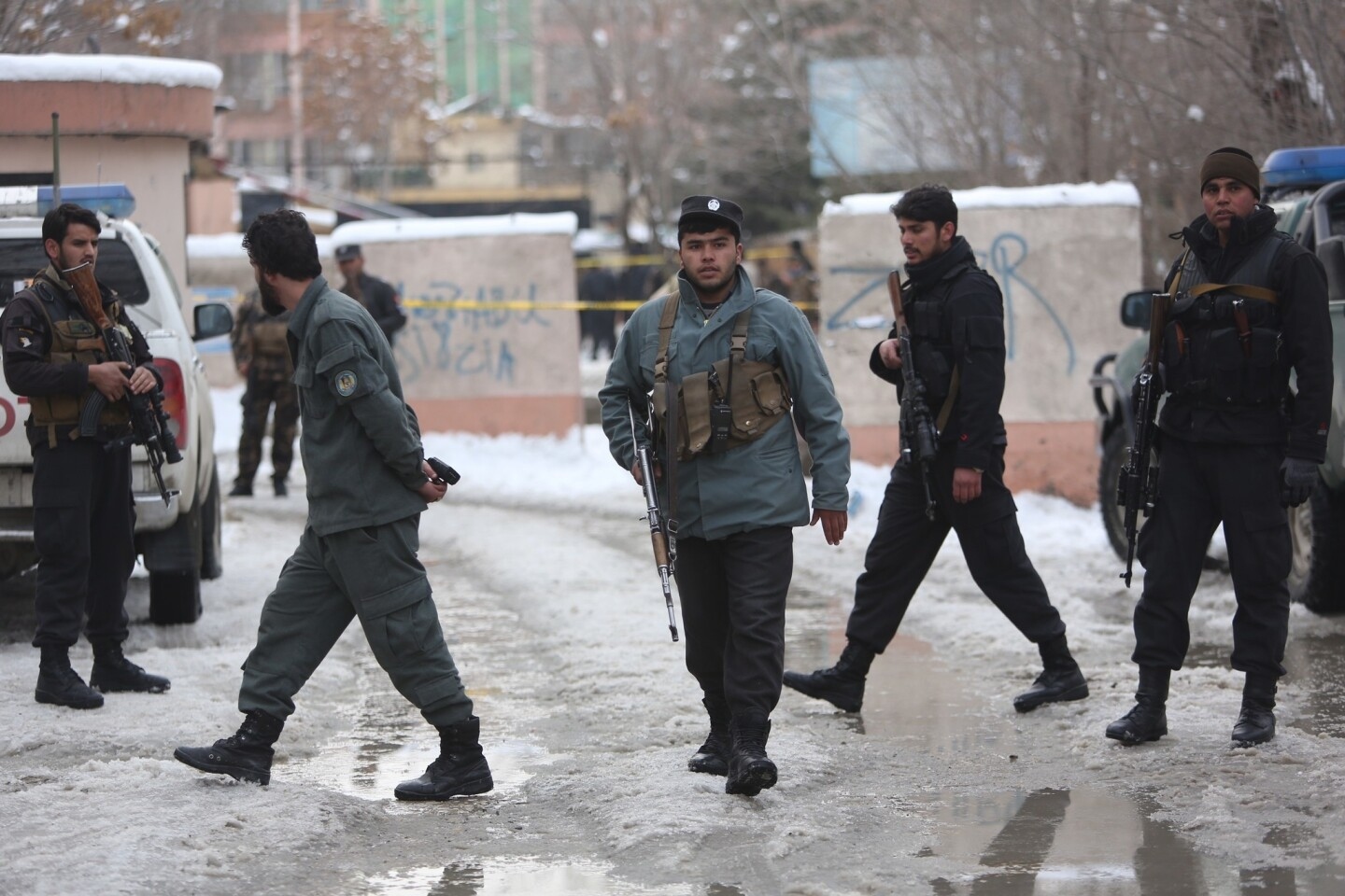 Police officers inspect the site of suicide attack at the Supreme Court in Kabul, Afghanistan, on Feb. 7, 2017.