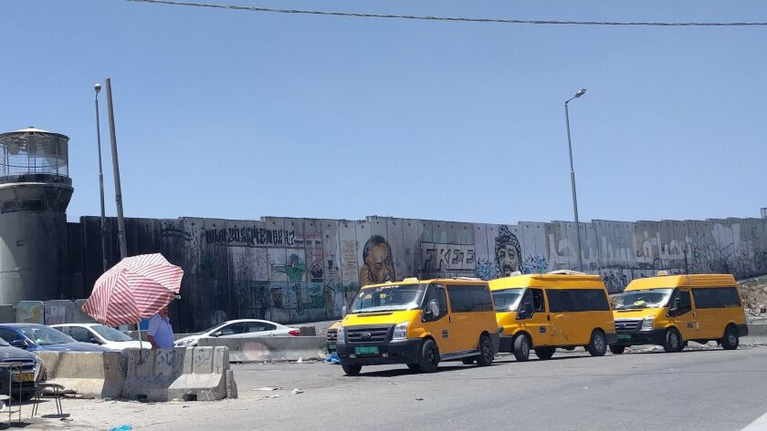 The backups at the heavily travelled Qalandia checkpoint snarl traffic in Kafr Aqab on a daily basi