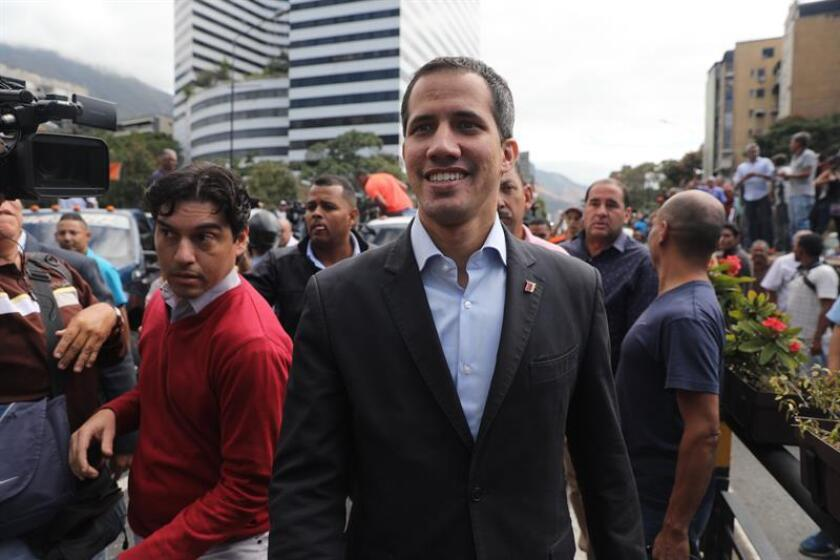 President of the National Assembly Juan Guaido (C) attends a rally of a group of drivers in Chacao, east Caracas, Venezuela, 20 February 2019, to demand the Government to allow the entrance of the humanitarian aid waiting in Colombia.EPA- EFE/ Miguel Gutierrez