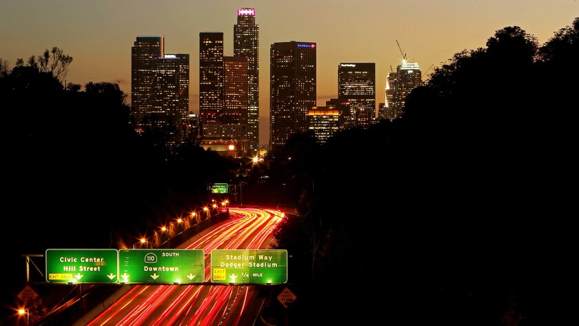 Southboaund traffic streams into downtown Los Angeles on the Pasadena Freeway.