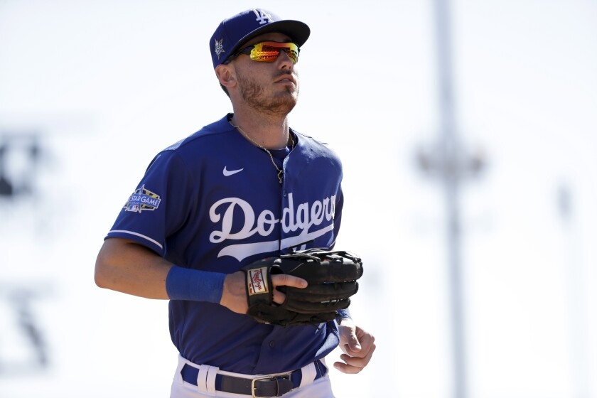 Los Angeles Dodgers center fielder Cody Bellinger runs off the field during the third inning of a spring training baseball game against the Los Angeles Angels, Wednesday, Feb. 26, 2020, in Glendale, Ariz. (AP Photo/Gregory Bull)