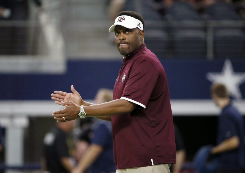 FILE - In this Saturday, Sept. 26, 2015 file photo, Texas A&M coach Kevin Sumlin applauds his team as players warm up for an NCAA college football game against Arkansas in Arlington, Texas. Steve Shaw has a busy week at the Southeastern Conference's annual meetings. Shaw, the league's coordinator o