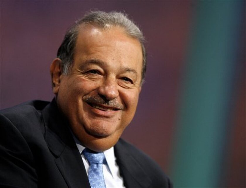 In this file photo, Carlos Slim speaks during a panel discussion at the Clinton Global Initiative Annual Meeting, Thursday, Sept. 27, 2007, in New York. The New York Times Co. says it has approved a $250 million investment bythe  Mexican telecommunications billionaire.  (AP Photo/Jason DeCrow)