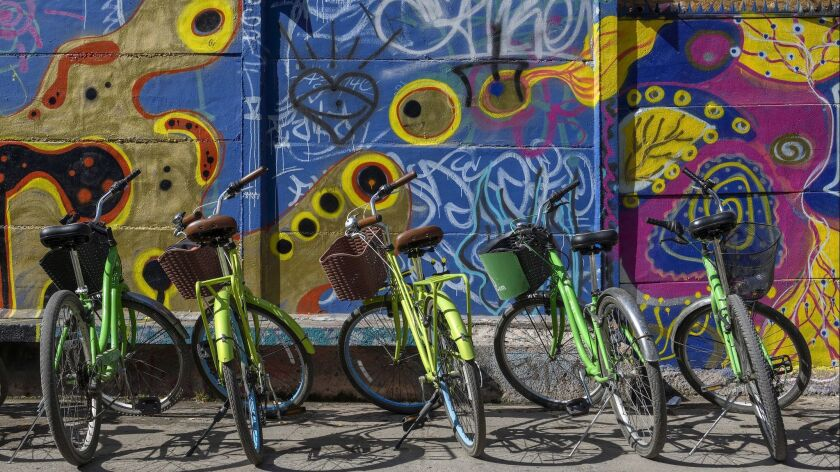 "SANTIAGO, CHILE – FEBRUARY 3, 2019: Bicycles from ""La bicicleta verde"" tour parked outside Pablo Ner"