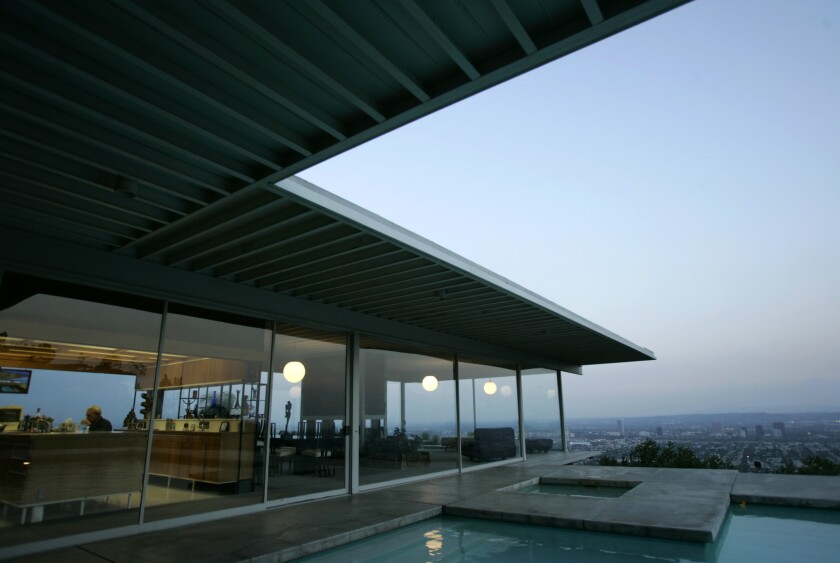 Walls of glass, classic post-and-beam construction, horizontal lines, geometric shapes and a playful sense of timeless style are hallmarks of a midcentury modern home.