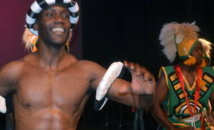 "Members of the Teye Sa Thiosanne African Drum & Dance Co. perform in ""Dancin' in the Street."""