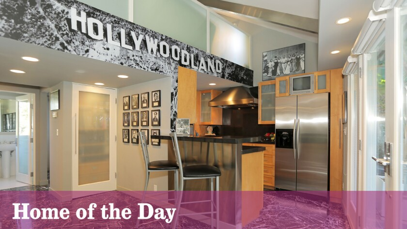 "A ""Hollywoodland"" accent wall adds an Old Hollywood element to the contemporary kitchen."