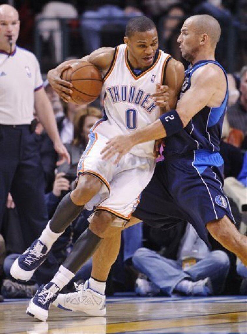 Oklahoma City Thunder guard Russell Westbrook, left, drives around Dallas Mavericks guard Jason Kidd, right, in the first quarter of an NBA basketball game in Oklahoma City, Monday, March 2, 2009. Oklahoma City won the game 96-87. (AP Photo/Sue Ogrocki)