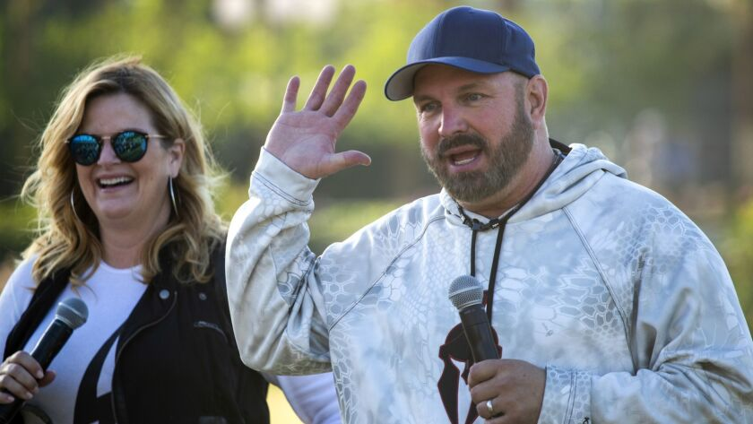 Trisha Yearwood and Garth Brooks answer questions from the media before performing Sunday to close out the three-day Stagecoach Country Music Festival in Indio.