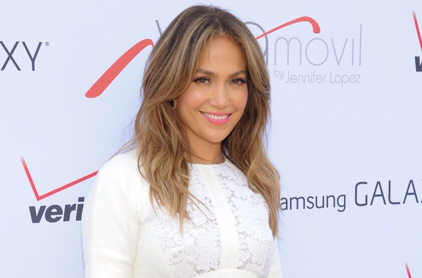 """FILE - This July 26, 2013 file photo shows singer and actress Jennifer Lopez at the """"Viva Movil by Jennifer Lopez"""" flagship store grand opening in the Brooklyn borough of New York. Lopez, the 44-year-old mother of 5-year-old twins, Maximilian and Emme, will receive the Grace Kelly Award at the March of Dimes luncheon at the Beverly Hills Hotel on Friday, Dec. 6, 2013. She's being recognized as a celebrity parent role model supporting women giving birth to healthy babies after full-term pregnancies.(Photo by Evan Agostini/Invision/AP, File)"""
