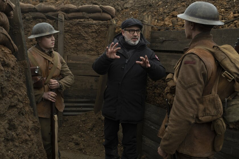 """Dean-Charles Chapman, left, Sam Mendes and George MacKay on the set of """"1917."""""""