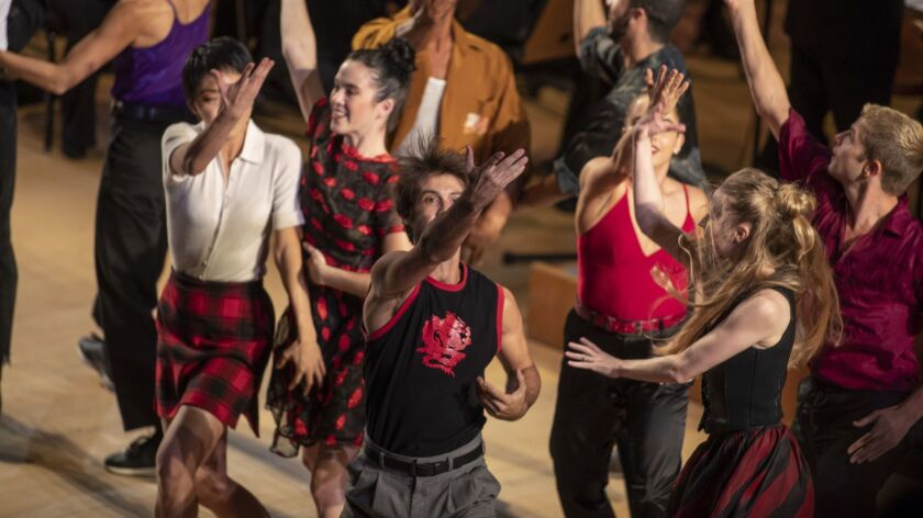 """Members of the L.A. Dance Project perform as Gustavo Dudamel conducts the L.A. Philharmonic in Prokofiev's """"Romeo and Juliet"""" on Thursday at Disney Hall."""