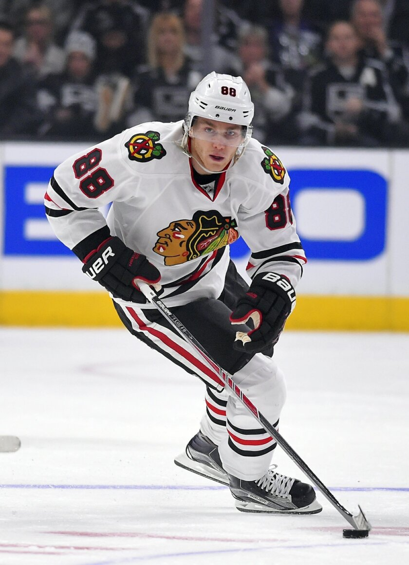 FILE - In this Jan. 28, 2015, file photo, Chicago Blackhawks right wing Patrick Kane moves the puck up ice during the first period of an NHL hockey game against the Los Angeles Kings in Los Angeles. The NHL playoffs kick off in style Wednesday, April 15, 2015, with the Blackhawks getting Kane back