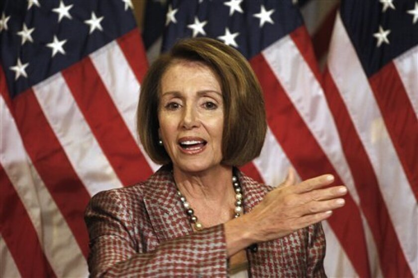 House Speaker Nancy Pelosi of Calif. gestures during her weekly news conference on Capitol Hill in Washington, Thursday, Sept. 24, 2009. (AP Photo/Harry Hamburg)