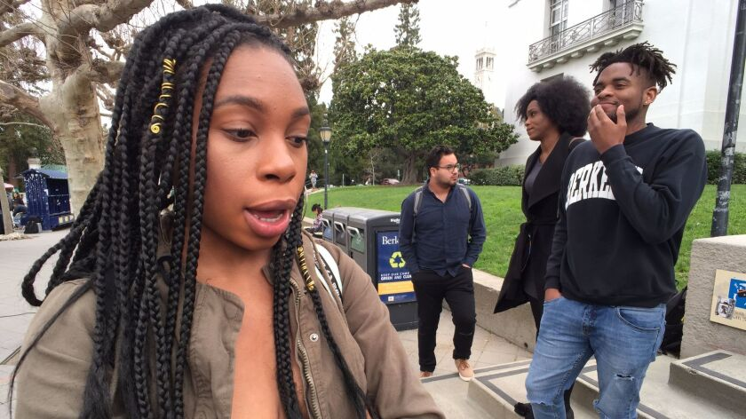 "Sociology major Carlisha Washington, 24, returned from a study abroad program to roommates who told her they did not want her using their dishes because of her ""germs."" Her fellow Black Student Union colleague, Key'Toya Burrell, 23, is on the steps in a black coat."