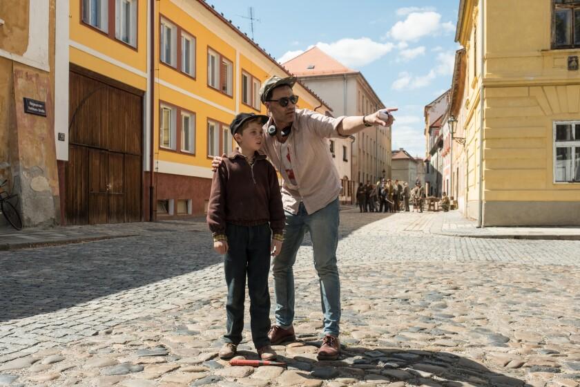 """Roman Griffin Davis and writer-director Taika Waititi on the set of """"Jojo Rabbit."""""""