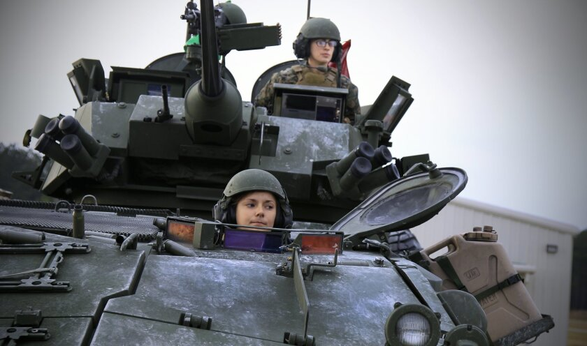 Lance Cpl. Ashleigh Howell and Lance Cpl. Brittany Dunklee served as light armored vehicle crew in the North Carolina-based Ground Combat Element Integrated Task Force, an experimental Marine Corps unit of men and women assigned to mixed-gender platoons.