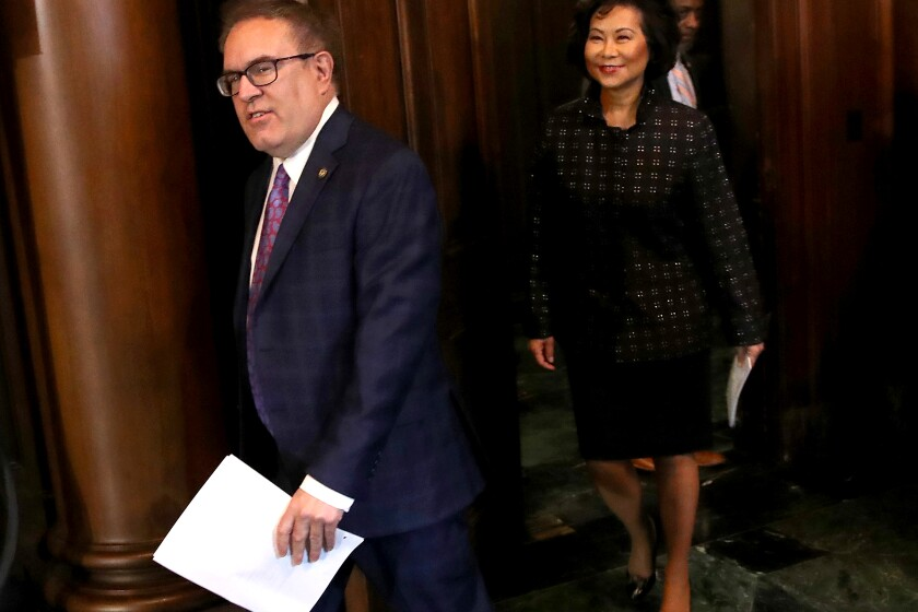 """WASHINGTON, DC - SEPTEMBER 19: Environmental Protection Agency Administrator Andrew Wheeler (L) and Transportation Secretary Elain Chao (R) arrive for a policy announcement at EPA headquarters September 19, 2019 in Washington, DC. Wheeler and Chao announced that the Trump administration would prohibit California from setting its own fuel economy standards, with Wheeler saying """"Federalism does not mean that one state can dictate standards for the rest of the country"""". (Photo by Win McNamee/Getty Images)"""