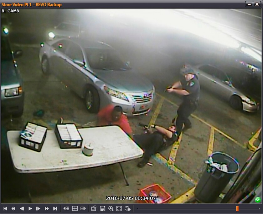 FILE - In this still image taken from security camera video provided March 30, 2018, by the Baton Rouge Police Department, officers Blane Salamoni and Howie Lake II confront Alton Sterling, left, during a struggle outside the Triple S Food Mart in Baton Rouge, La., in July 2016. After a $5 million proposed settlement fell through, Louisiana officials on Wednesday, Feb. 10, 2021, offered $4.5 million to settle the civil lawsuit brought by the family of Alton Sterling, a Black man who was killed in 2016 by police who approached him while he was selling homemade CDs in front of a convenience store. (Courtesy of Baton Rouge Police Department via AP)