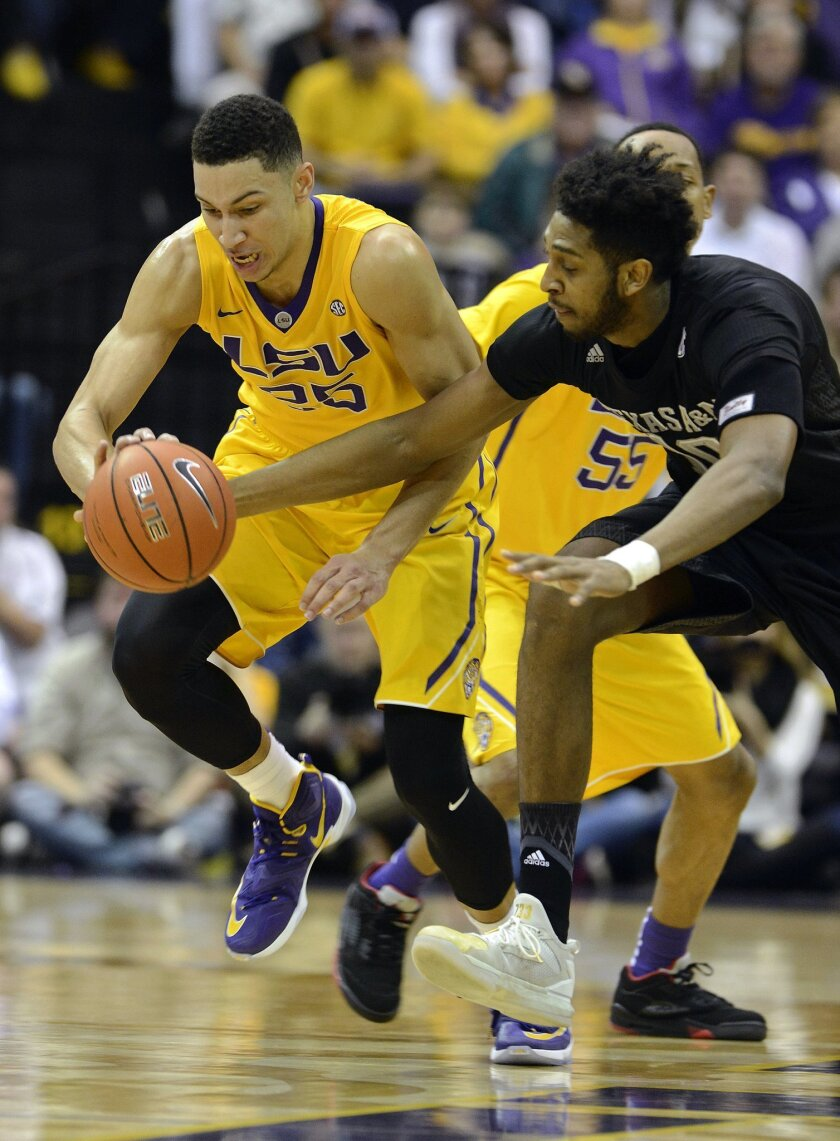 LSU forward Ben Simmons (25) steals the ball from Texas A&M center Tonny Trocha-Morelos, right, in the first half of an NCAA college basketball game in Baton Rouge, La., Saturday, Feb. 13, 2016. (AP Photo/Bill Feig)