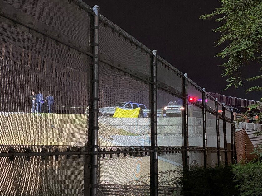 A yellow tarp covers the body of a person who was fatally shot by a Border Patrol agent Friday evening in San Ysidro.