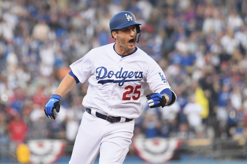 Dodgers first baseman David Freese retired from baseball Saturday after 11 seasons.
