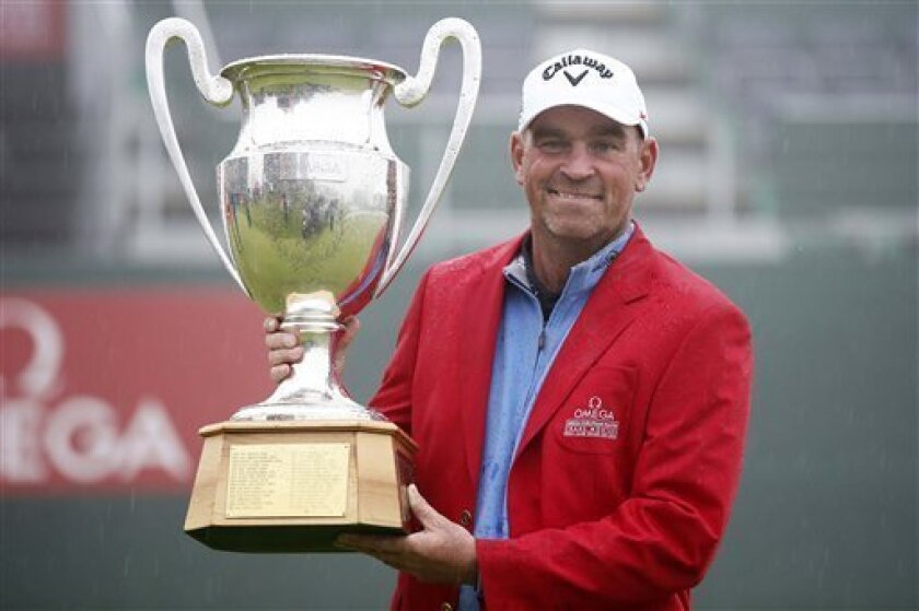Thomas Bjoern of Denmark poses with the trophy after winning the Omega European Masters Golf Tournament in Crans-Montana, Switzerland, Sunday, Sept. 8, 2013. Thomas Bjorn beat Craig Lee in a single-hole playoff for the European Masters title Sunday, after both finished with 20-under totals of 264. Bjorn, the 2011 champion from Denmark, sank his 12-foot putt for birdie on the par-4 18th after Scotsman Lee's attempt from 15 feet slid left of the hole. Earlier, both players missed 20-footers on