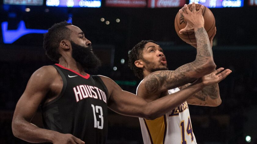 Los Angeles Lakers forward Brandon Ingram goes up for a basket as Houston Rockets guard James Harden defends him during the second half.
