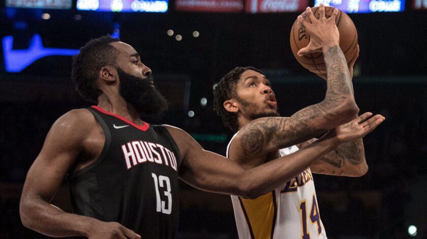 Los Angeles Lakers forward Brandon Ingram (14) goes up for a basket as Houston Rockets guard James H