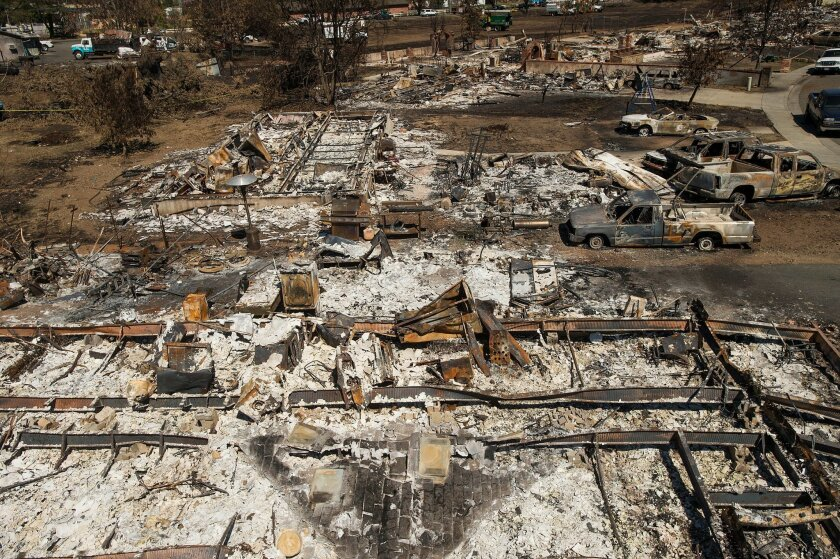 FILE- This Sept. 21, 2015, file photo shows shows remains of homes and vehicles scorched by a wildfire in Middletown, Calif. President Barack Obama declared a major disaster Tuesday, Sept. 22, in a deadly Northern California wildfire that has destroyed thousands of homes. (AP Photo/Noah Berger, File)