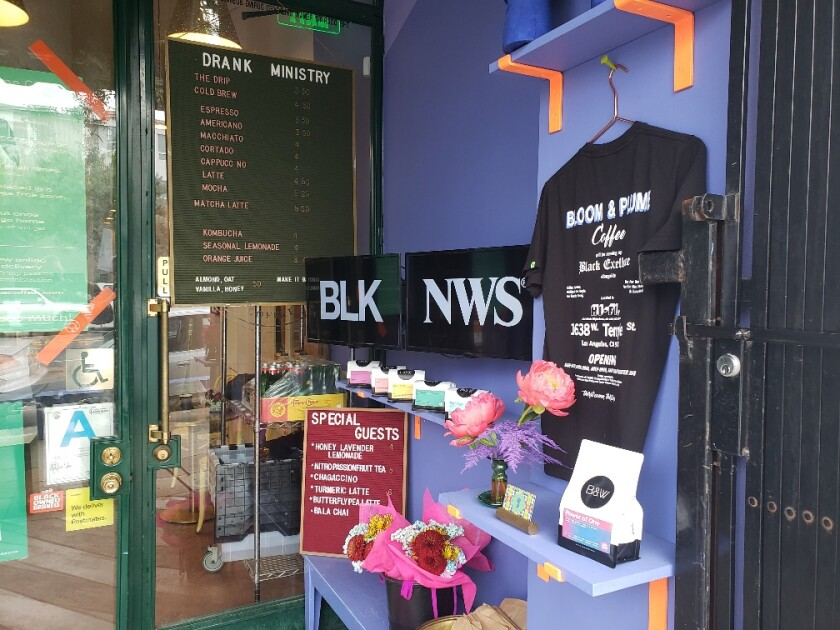 """Kahlil Joseph's """"BLKNWS®"""" plays on a pair of screens at Bloom & Plume coffee shop in Historic Filipinotown."""